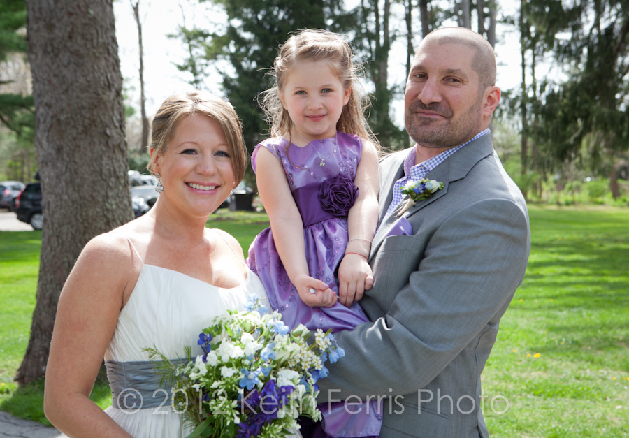 the bride and groom with their daughter at Inn at Stone Ridge