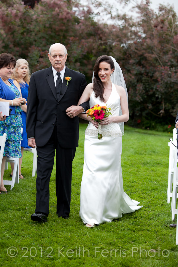 father and daughter walk down the aisle