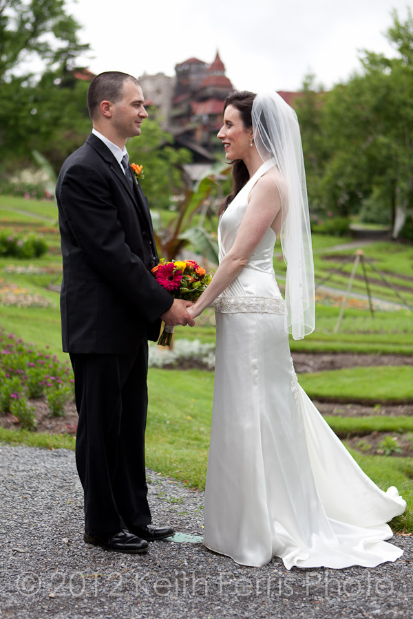 bride and groom in front of mohonk mountain house