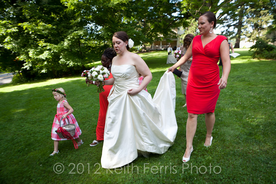 The bride and her maid of honor walk to the ceremony