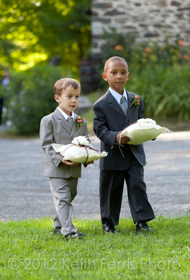 The ring bearers walk down the aisle at Shadow Lawn wedding