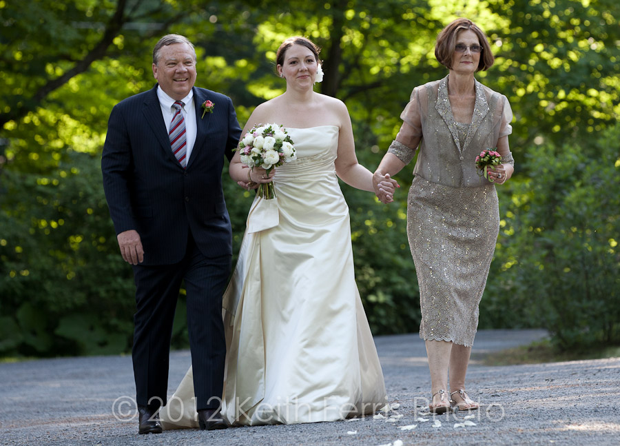 The bride and her parents walk down the aisle in Marbletown