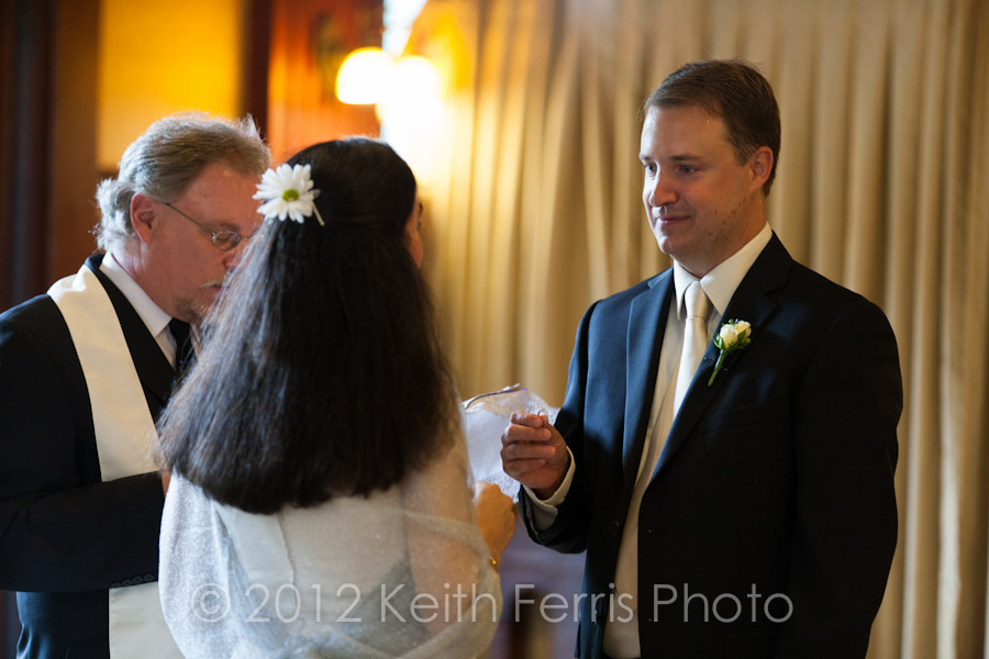 the bride and groom exchange rings in the parlor at mohonk wedding