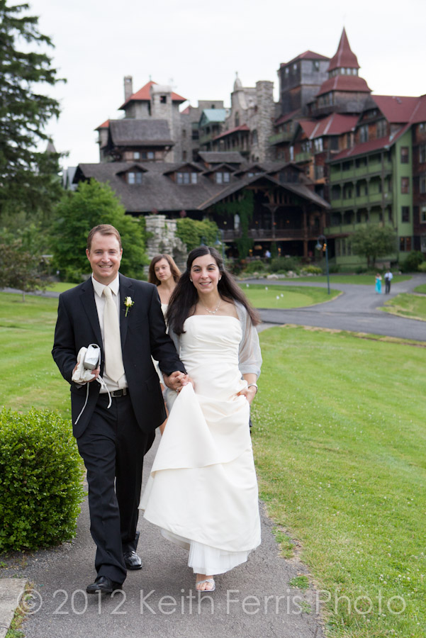 The bride and groom walk to the garden for pictures at Mohonk Mountain House wedding