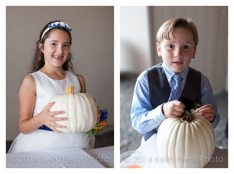 kids with pumpkins at a fall wedding