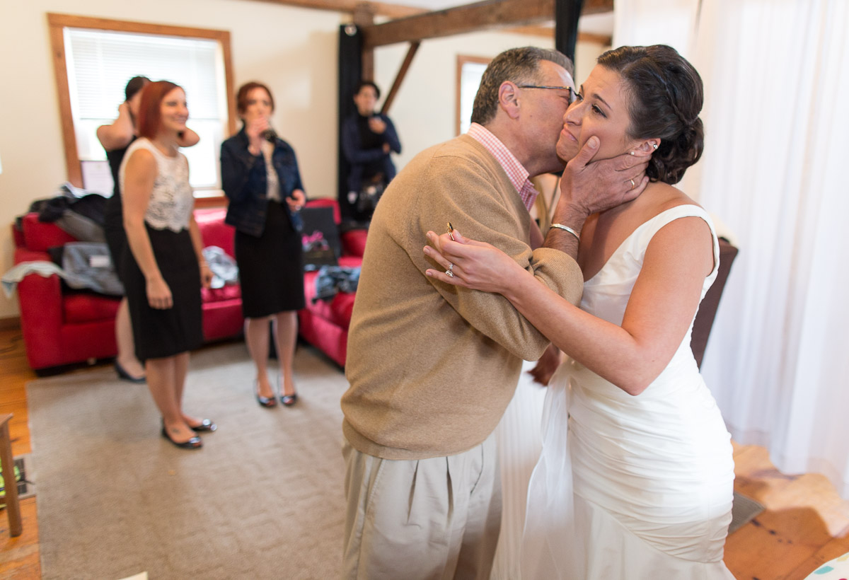 bride with her father in the carriage house