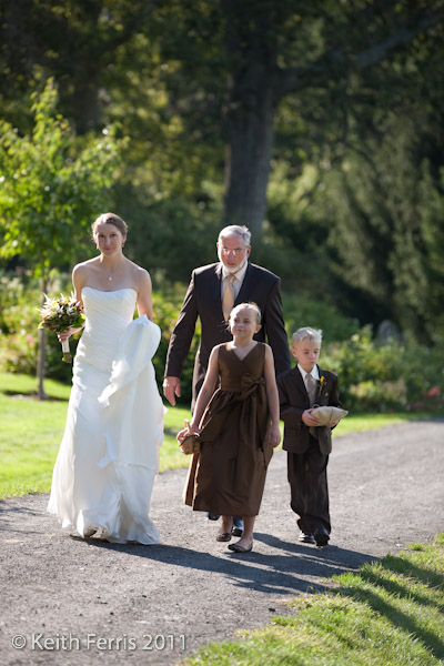 beautiful bride with flower girl and ring bearer