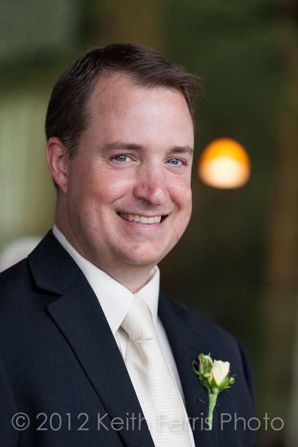 grooms portrait on the porch at Mohonk