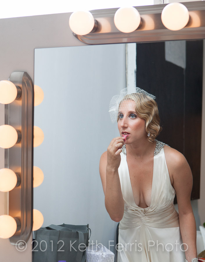 the bride touches up her makeup in Long Island City NY