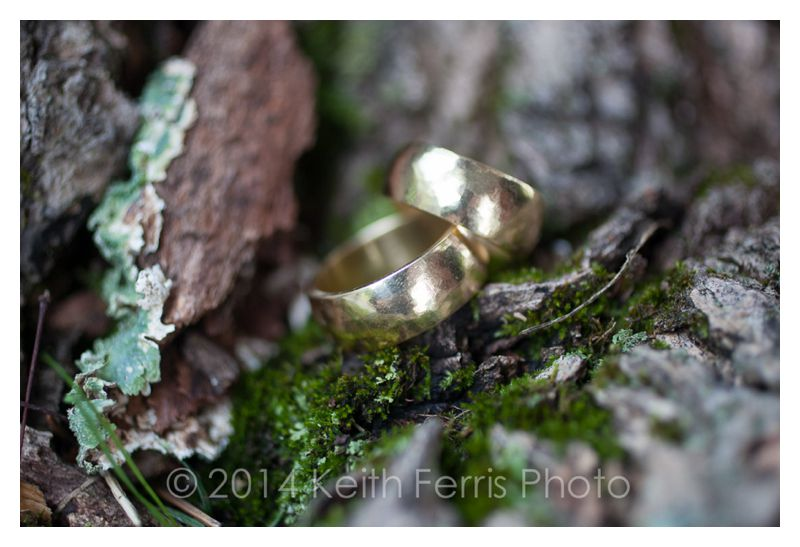 wedding ring detail with moss