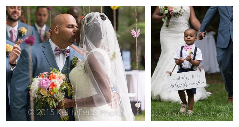 first kiss and boy holding a sign in front of the newlyweds